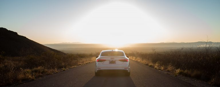 Audi driving on open road